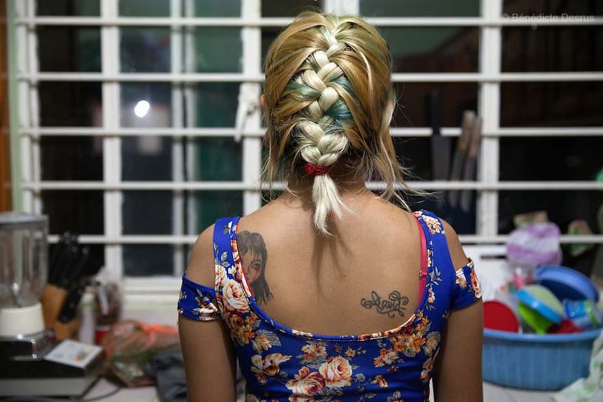 Xochiquetzal S&aacute;nchez Escobar at her home in Juchit&aacute;n, Mexico on February 17, 2016. <br /> Despite her teenage rebel style, Xochi, as she is known, dressed in the traditional Zapotec style for her engagement party. She is 17 and five months pregnant. The daughter of a single-mother former missionary and nun, Xochi says she had always talked about having a baby in her teens because she thought her mother was old when she had her at 28. She kept her pregnancy secret from her mother until February. After the baby - a boy, David Mateo - is born in June, she plans to move with her boyfriend to a house where they will live together and he will have his tattoo studio, and they plan to marry next June. She plans to finish her final year of secondary school in the town of El Espinal in the southern Mexican state of Oaxaca next year, with her mother looking after the baby in the mornings while she is in class. Being a schoolgirl housewife does not worry her, she says, although she admits she cannot cook. Her grandmother, who lives with the family, is thrilled at the prospect of a great-grandchild. Xochi dreams of giving birth in water, but is not sure that will happen. While Mexico has outlawed marriage under the age of 18, many young girls become unofficial wives and mothers much earlier. In Juchit&aacute;n, teenage pregnancy is expected, even prized. Mexico ranks first in teenage pregnancies among the member countries of the Organization for Economic Co-operation and Development&nbsp;(OECD). Photo by B&eacute;n&eacute;dicte Desrus