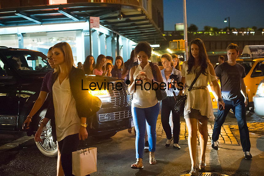 Hordes of shoppers descend on the trendy Meatpacking District in New York on Thursday, September 6, 2012 during the fourth annual Fashion's Night Out event. On the first evening of New York Fashion Week stores around the city offer sales and bargains as well as parties and events to entice customers to shop. The event has been so successful in boosting sales that over 100 cities in the US are having their own events, and Fashion's Night Out events occur in fashion-forward cities around the world. (© Frances M. Roberts)