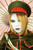Portrait of a cos-play girl or Harajuku cos player girl in a military uniform with a white face. Harajuku, Tokyo, Japan May 2004
