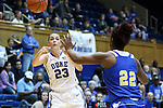 30 October 2014: Duke's Rebecca Greenwell (23) passes over Limestone's Aaliyah Davis (22). The Duke University Blue Devils hosted the Limestone College Saints at Cameron Indoor Stadium in Durham, North Carolina in an NCAA Women's Basketball exhibition game. Duke won the game 100-33.