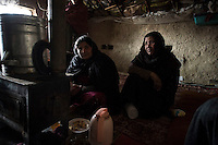 Refugees at the Stadium camp in Kabul. 1-1-14 The camp is threated with eviction as the land it is on has been bought by a developer. Winter is a particulalry difficult time for the landless people who had previously fled the war with the Russians.