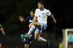 06 October 2015: North Carolina's Alex Comsia (CAN) (4) and UNCW's Daniel Escobar (COL) (behind). The University of North Carolina Tar Heels hosted the University of North Carolina Wilmington Seahawks at Fetzer Field in Chapel Hill, NC in a 2015 NCAA Division I Men's Soccer match. North Carolina won the game 3-0.