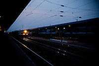 Evening landscape view of a train entering a train station near the Sānménxiá Shì Húbīn District in Hénán Province.  © LAN