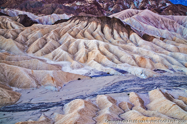 Zabriskie Point in Death Valley is a popular tourist attraction and offers a dramatic view of the complex geology of the National Park.
