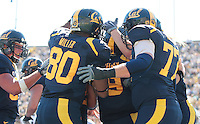 Cal players celebrate with Beau Sweeney after the touchdown. The University of California Berkeley Golden Bears defeated the UC Davis Aggies 52-3 in their home opener at Memorial Stadium in Berkeley, California on September 4th, 2010.