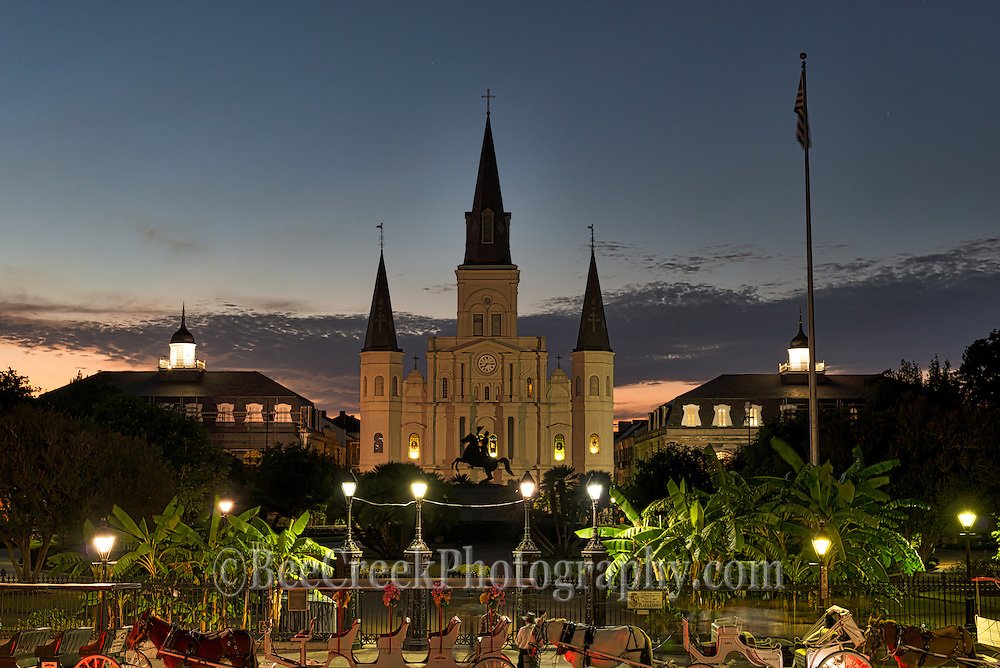 The Jackson Square is a historic park in the French Quarter of New Orleans, Louisiana.  It is a site where artist come to sell their wares, or play their music it is also a good place to have your palm read or catch a ride around the city on a horse drawn carriage.  In the background you see the Saint Louis Cathedral along with the Jackson statue. This area of the French Quarter,  is the oldest neighborhood in the city of New Orleans. After New Orleans was founded in 1718 by Jean-Baptiste Le Moyne de Bienville, the city developed around the &quot;Old Square&quot;, a central square. The district is more commonly called the French Quarter today, or simply &quot;The Quarter,&quot; related to changes in the city with American immigration after the Louisiana Purchase. Most of the historic buildings were constructed either in the late 18th century, during the city's period of Spanish rule, or were built during the first half of the 19th century, after U.S. annexation and statehood.<br /> The area gas beeb deckared a National Historic Landmark, with numerous contributing buildings that are separately deemed significant. It is a prime tourist destination in the city, as well as attracting local residents.