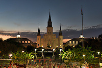 The Jackson Square is a historic park in the French Quarter of New Orleans, Louisiana.  It is a site where artist come to sell their wares, or play their music it is also a good place to have your palm read or catch a ride around the city on a horse drawn carriage.  In the background you see the Saint Louis Cathedral along with the Jackson statue. This area of the French Quarter,  is the oldest neighborhood in the city of New Orleans. After New Orleans was founded in 1718 by Jean-Baptiste Le Moyne de Bienville, the city developed around the &quot;Old Square&quot;, a central square. The district is more commonly called the French Quarter today, or simply &quot;The Quarter,&quot; related to changes in the city with American immigration after the Louisiana Purchase. Most of the historic buildings were constructed either in the late 18th century, during the city's period of Spanish rule, or were built during the first half of the 19th century, after U.S. annexation and statehood.<br />