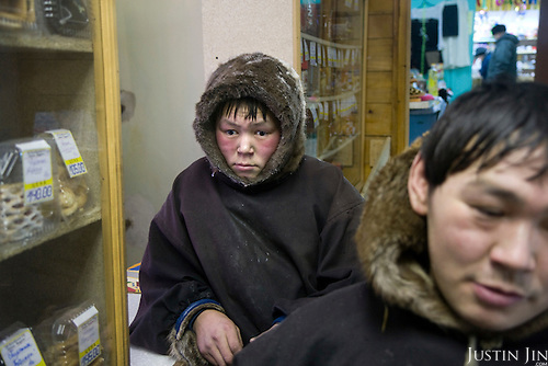 Reindeer herders Simyon and Vanya travel hours by sled from their tent in the tundra to buy supplies at the village shop in Sovetsky..Nomadic people like them have a mutually cautious relationship with the Russians who live in the Far North..Vorkuta is a coal mining and former Gulag town 1,200 miles north east of Moscow, beyond the Arctic Circle, where temperatures in winter drop to -50C. .Here, whole villages are being slowly deserted and reclaimed by snow, while the financial crisis is squeezing coal mining companies that already struggle to find workers..Moscow says its Far North is a strategic region, targeting huge investment to exploit its oil and gas resources. But there is a paradox: the Far North is actually dying. Every year thousands of people from towns and cities in the Russian Arctic are fleeing south. The system of subsidies that propped up Siberia and the Arctic in the Soviet times has crumbled. Now there?s no advantage to living in the Far North - salaries are no higher than in central Russia and prices for goods are higher.