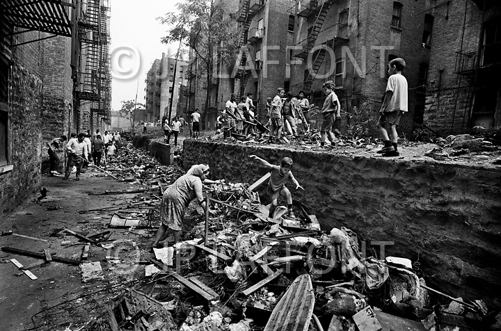 Bronx, New York City, NY. July 1966. <br /> Sanitation in the Bronx. Lots of people cleaning voluntarily. Younger kids would play around while older ones would help with the cleaning.<br /> From the mid-1960s to the late-1970s, quality of life for Bronx residents declined sharply.