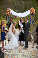 A bride and groom laugh during their wedding at Plumb Jack, Squaw Valley, Tahoe, California.