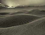 Sunset over the sand dunes at Mesquite Flats in Death Valley
