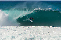 PIPELINE, Oahu/Hawaii (Saturday, December 14, 2013) Joel Parkinson (AUS) . - Kelly Slater (USA), 41, has won his 7th Billabong Pipe Masters in Memory of Andy Irons after a day of incredible 10-to-15 foot (three to four metre) waves at Pipeline today. Slater defeated John John Florence (HAW), 21, in a hard-fought, 35-minute Final that ended with less than half-a-point separating the two. The runner-up finish for Florence saw him crowned 2013 Vans Triple Crown of Surfing champion.<br /> <br /> The final day of the Billabong Pipe Masters capped off the 2013 ASP World Championship Tour (WCT) season in fine style, with epic conditions providing the ideal backdrop for the crowning of Mick Fanning (AUS), 32, as the ASP World Champion. It also finalized the ASP Top 34 roster for 2014. Fanning finished third overall, defeated by Florence in their Semifinal.<br /> With tens of thousands packing the beach at Pipeline, and the gravitas of Slater&rsquo;s 56th elite tour victory apparent, the greatest athlete the sport has ever produced was emotional on the final day of 2013.<br /> <br /> Fanning&rsquo;s road to the 2013 ASP World Title was nothing short of spectacular on the final day of competition. Finding himself behind during both his Round 5 and Quarterfinals bouts, the iron-nerved Australian nailed huge Pipeline scores in both occasions to take the heat wins and his third world surfing crown.<br /> <br /> &ldquo;I&rsquo;ve never put myself in the same circles as Tom Curren and Andy Irons,&rdquo; Fanning said. &ldquo;Tom (Curren) is such an enigma and was so instrumental to injecting style into our sport. Andy (Irons)&hellip;what hasn&rsquo;t been said about Andy? He was such a legend and he was such a good friend. I&rsquo;m honored to be a part of this group. I was happy with one title and I was overwhelmed with two. With three? I don&rsquo;t have words for that.&rdquo;<br /> <br /> Today marked John John Florence&rsquo;s second Vans Triple Crown Title, but his runner-up in the final event forces him to hang on to his life-long dream of one day hoisting the Pipe Masters tro