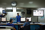 Engineers work at monitoring output and demand levels in a control room at the Doura power plant August 26, 2010 in Baghdad, Iraq. Residents in Baghdad still experience severe power shortages and rolling blackouts daily as capacity has been outpaced by demand.  .