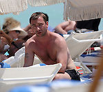 ***EXCLUSIVE*** Charlie Condou Relaxing at Miami Beach