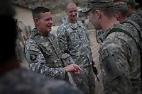 US Army General Schloesser hands out awards during a visit to bases in the Pesh and Korengal Valley, epicentre of the war and scene of fierce fighting with the Taliban.