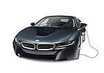 Black 2016 BMW i8 plug-in hybrid electric luxury sports car with charging cord isolated on white background with clipping path