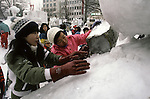 Ice sculpture teams work on their masterpiece in Odori Park. These are not traditional Frosty the Snowmen, but huge carved and chiseled Samurai Warriors, Buddhists gods, historical heroes of fairy tales and Walt Disney characters. Some stand as big as buildings. Chiseled out of tons of packed snow, the sculptures are the pride and job of the residents of Sapporo, Japan, who hosts the world famous Ice and Snow Sculpture Festival for five days in early February.Themes of the sculptures are picked from Kabuki stages, historical characters or fairy tales. (Jim Bryant Photo).....