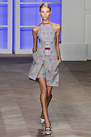 Vika Falileeva walks the runway in a orange/blue glen plaid one-piece bathing suit with an orange trim, and orange/blue glen plaid cotton skort, by Tommy Hilfiger for the Tommy Hilfiger Spring 2012 Pop Prep Collection, during Mercedes-Benz Fashion Week Spring 2012.