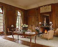 This formal drawing room has antique boiserie and a sculpted stone mantelpiece
