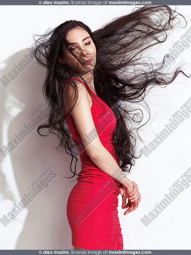Japanese woman in red dress with waist long flying black hair on white background
