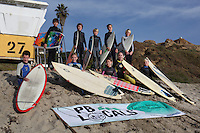 Pacific Beach, San Diego CA, USA.  Wednesday, January 9 2013:  Members of the PB Locals Surf Club from PB Middle School pose near tower 27 before heading out into the water for an afternoon training session.  The after school team meets every Wednesday about two hours before sunset to train for weekend competitions.