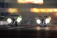 May 18, 2012; Topeka, KS, USA: NHRA top fuel dragster driver Brandon Bernstein (right) races alongside Shawn Langdon during qualifying for the Summer Nationals at Heartland Park Topeka. Mandatory Credit: Mark J. Rebilas-
