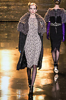"Diana Farkhullina walks runway in a charcoal knitted wool tweed & ""lamb"" coat, with blush/black wool lace dress, from the Badgley Mischka Fall 2011 fashion show, during Mercedes-Benz Fashion Week Fall 2011."