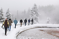Tourists on Stop with Snowcoach Tour, Midway Geyser Basin, Yellowstone National Park, Winter, Wyoming, United States of America.Tourists on Stop with Snowcoach Tour, Fountain Paint Pot, Yellowstone National Park, Winter, Wyoming, United States of America.