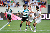 Garreth Bale (3) of Tottenham Hotspur F. C. plays a ball in front of Matias (14) of Sporting Clube de Portugal. Tottenham Hotspur F. C. and Sporting Clube de Portugal played to a 2-2 tie during a Barclays New York Challenge match at Red Bull Arena in Harrison, NJ, on July 25, 2010.
