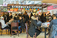 Shoppers pack Starbucks in the Queens Center Mall in the borough of Queens in New York on the so-called Super Saturday, December19, 2015. Restaurant and food service sales are expected to increase as shoppers add dining to their shopping expeditions.  (© Richard B. Levine)