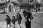 Chiswick Women Aid Shelter for Battered Women. London England 1976. Mothers and their children who are staying in the hosel walking to local shops.