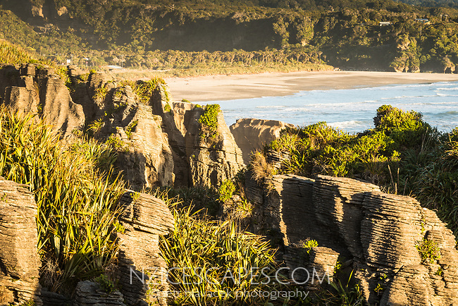 Photo of Pancake Rocks at sunset, limestone formations on wild coast in Punakaiki, Paparoa National Park, Buller Region, West Coast, New Zealand, NZ