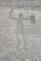 Petroglyph, rock carving, of a warriors with a shield and sword. Carved by the ancient Camunni people in the iron age between 1000-1200 BC. Rock no 6, Foppi di Nadro, Riserva Naturale Incisioni Rupestri di Ceto, Cimbergo e Paspardo, Capo di Ponti, Valcamonica (Val Camonica), Lombardy plain, Italy