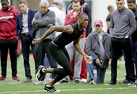 NWA Democrat-Gazette/DAVID GOTTSCHALK  Dominique Reed participates in a cone drill Wednesday, March 15, 2017, during the Arkansas Pro Day inside the Walker Pavilion on the campus of the University of Arkansas in Fayetteville.