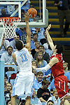 21 December 2013: North Carolina's Brice Johnson (11) blocks a shot by Davidson's Davidson's Jake Belford (right). The University of North Carolina Tar Heels played the Davidson College Wildcats at the Dean E. Smith Center in Chapel Hill, North Carolina in a 2013-14 NCAA Division I Men's Basketball game. UNC won the game 97-85 in overtime.