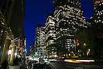 A street view of Manhattan at night.