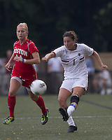 Boston College forward Victoria DiMartino (1) passes the ball as Boston University midfielder Katherine Donnelly (14) closes. After 2 complete overtime periods, Boston College tied Boston University, 1-1, after 2 overtime periods at Newton Soccer Field, August 19, 2011.