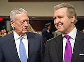 US Marine Corps General James N. Mattis (retired), left and former US Secretary of Defense William Cohen, right, share a thought prior to the US Senate Committee on Armed Services confirmation hearing on Mattis' nomination to be US Secretary of Defense on Capitol Hill in Washington, DC on Thursday, January 12, 2017.  Cohen, who also served in the US Senate as a Republican from Maine, introduced and endorsed Mattis.<br /> Credit: Ron Sachs / CNP