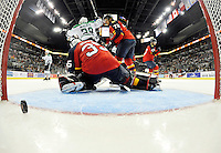 Florida Panthers goalkeeper Michael Houser is scored on by Dallas Stars' Curtis McKenzie during the third period of an NHL preseason hockey game, Friday, Sept. 20, 2013, in San Antonio, Texas. Dallas won 4-1. (Darren Abate/DA Media)