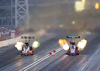 Oct 28, 2016; Las Vegas, NV, USA; NHRA top fuel driver Doug Kalitta (left) races alongside Antron Brown during qualifying for the Toyota Nationals at The Strip at Las Vegas Motor Speedway. Mandatory Credit: Mark J. Rebilas-USA TODAY Sports