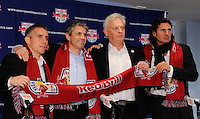 New York Red Bulls assistant coach Richie Williams, general manager and sportsing director Erik Soler, head coach Hans Backe, and goalkeeper coach Des McAleenan pose for photographers during a press cenference at Red Bull Arena in Harrison, NJ, on January 13, 2010.