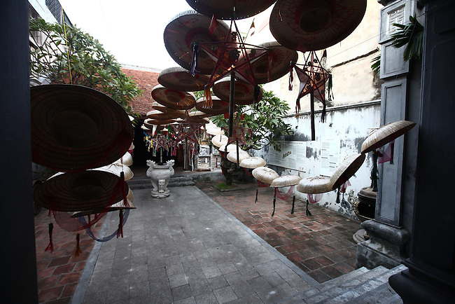 Straw hats and other items decorate the entrance to an ancient house where traditional concerts are often performed in the Old Quarter of Hanoi, Vietnam. Nov. 12, 2012.