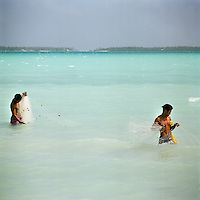 Men reef fishing in the lagoon.