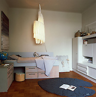 A child's bedroom is functional and practical with plenty of storage space