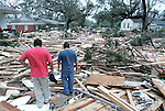What is left of the approx 150 units of St Charles Condominiums and Sadler Apartments in Biloxi, Mississippi were pushed up between the private homes on St Charles St by the storm surge from Hurricane Katrina August 29, 2005.   Early reports p;ut the death toll at 40 along the Mississippi coast., 30 at this location alone.