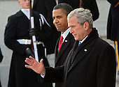 Washington, DC - January 20, 2009 -- United States President Barack Obama looks on as former United States President George W. Bush waves from the steps of the the East Front of the U.S. Capitol on Tuesday, January 20, 2009 in Washington, DC. Obama becomes the first African-American to be elected to the office of President in the history of the United States.  .Credit: John Moore / Pool via CNP
