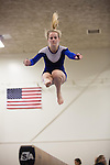 A member of the Los Altos High School gymnastics team performs her beam routine at a school meet.