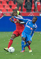 20 October 2012: Toronto FC defender Jeremy Hall #25 and Montreal Impact midfielder Sanna Nyassi #11 in action during an MLS game between the Montreal Impact and Toronto FC at BMO Field in Toronto, Ontario Canada. ..