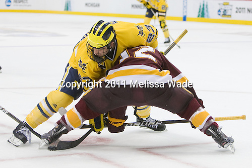 Luke Glendening (Michigan - 23), Jack Connolly (Duluth - 12) - The University of Minnesota-Duluth Bulldogs defeated the University of Michigan Wolverines 3-2 (OT) to win the 2011 D1 National Championship on Saturday, April 9, 2011, at the Xcel Energy Center in St. Paul, Minnesota.