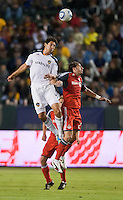 CARSON, CA – June 11, 2011: LA Galaxy defender Omar Gonzalez (4) and Toronto FC forward Alan Gordon (21) go up to head the ball during the match between LA Galaxy and Toronto FC at the Home Depot Center in Carson, California. Final score LA Galaxy 2, Toronto FC 2.